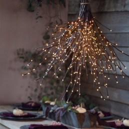 Create a lit branch chandelier