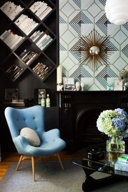 black shelves gold accents library den