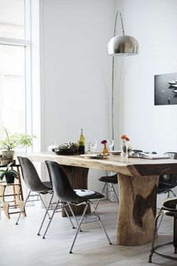 Raw dining table in modern setting
