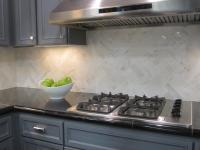 herring bone kitchen white marble backsplash