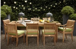 Subtle teak dining with rope lights above
