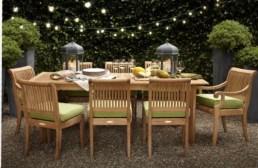 Subtle teak dining with rope lights above