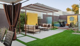 Zoned space by using landscaping, color blocking and arbour.