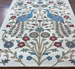area rug with peacocks
