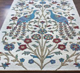 area rug with peacocks