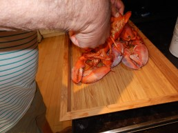 Cutting the lobster.