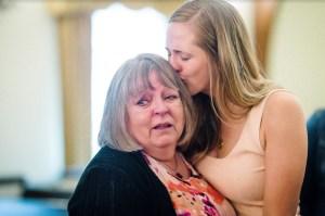 Ella's Mom Kisses Ella's Grandmother as They Both Mourn the Loss of a Ella