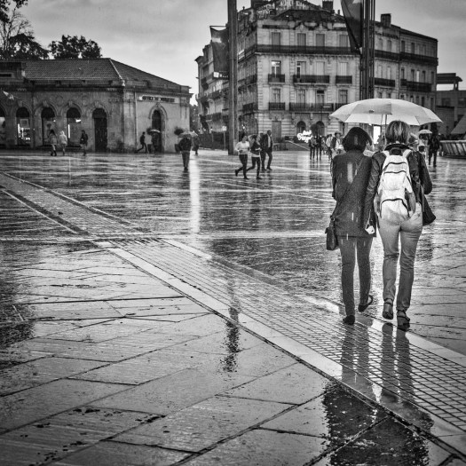 The other day I was walking around the streets of old Montpellier in the afternoon. Is was a fun thing to do but towards the end of the day it started to rain. For most people that poses an inconvenience but for me it increases the possibilities for photos because of the reflections on the ground and reactions of people. Here I am walking back to a parking garage behind a couple of ladies sharing an umbrella. I ended up soaked to the bone but was pretty happy with some of the images. I was also glad I had a warm jacket in the car to change into.
