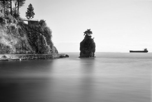 This is Siwash Rock which is at the western tip of Stanley Park in Vancouver. The first time I walked around the seawall I was struck by it's shape and position, as though it were some mystical sentinel. I've tried several times to take a picture of this with poor results, in fact I was a little obsessed with this. How so? Well, when I'm in Vancouver I stay at the Marriott, and in each room of that hotel is the same black and white photograph of this rock, from roughly the same position. I don't know who took that photo, but who ever you are it'a a really beautiful shot. So, I had it in my mind to do something like that. This is my spin, as it were, but of course I'm emulating another photographer who's work is in every room of the Marriott. So there you have it, I got my inspiration from a hotel wall.