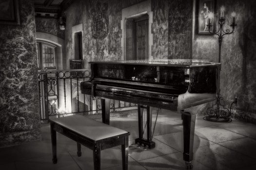 This is a piano I found in a corner of the Scottish castle otherwise known as the Banff Springs Hotel, in Banff Alberta. When I was there I took quite a few photos of the place which is a small measure of how impressed I was by the ambiance and architecture. If anyone ever invents a time machine, this is the place I'd like to visit fifty or a hundred years ago. From the looks of the furnishings I'd think little has changed, it's as though the place was cut right out of a movie set and a playground for the rich and famous. Perhaps the only difference now is that people like me, not so rich and famous, can wander the halls and get lost in reverie and imagination.