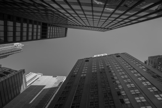 I was walking with some friends towards a diner for breakfast and just randomly looked up. I thought this view was cool and I almost lost track of my group as I lingered for this shot. There are a lot of places like this in the city.  I think it would be a fun project to shoot this perspective from different locations all over Manhattan. So maybe perhaps this is the first of a series, just maybe.
