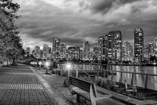 This is False Creek in Vancouver where I sat one evening to take in the sights of the city. Seems there's so much to see that you have to take it all in one little chunk at a time. If you have nothing better to do (or even if you do) you can just sit here on a bench and scan from left to right. I've spent a lot of time walking around here at night and it feels safe, lot's of people do it, strength in numbers. The other thing is that if I walk too far I can always catch the subway or a cab, the city is about as cosmopolitan as they come. And I thought Cosmopolitan was a cocktail, silly me.