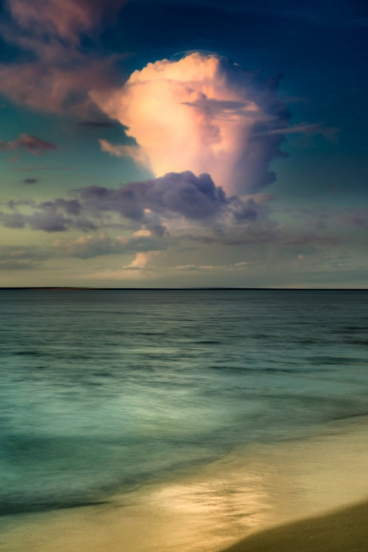 A lone thundercloud floats over the Gulf of Mexico near Tampa Florida. This is a common sight most of the year; they resemble pillars rising with a powerful force that is best viewed from a distance. Such was the case on this warm evening a few months ago on Anna Maria Island not far from my home.