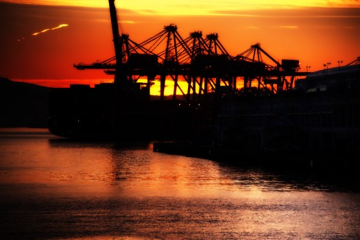 In addition to cruise ships, a convention center and sight seeing, Vancouver Harbour is a busy shipping port. This morning I focused my lens on the industrial side of things as the sun was rising behind the cranes. Despite all the boat and seaplane traffic, the water remains crystal clear. I'm not sure how they manage that but thankfully they do. In any case, if you've ever seen pictures of English Bay (including my own) which surrounds Vancouver, you'll notice  many container ships docked offshore. My guess is they are waiting to take on a shipment of containers from here and head back out to sea. If you climb up one of the surrounding mountains and look back, you'll see these ships lined up end-to-end for miles out into the bay. The first time you see them it's quite a site, but in time you grow accustom to their presence and you almost forget they're there. Day in, day out, they file in and out this port and this was just the start of another busy day.