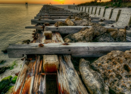 Another shot of another old pier at sunset, but come to think about it the sunset was just an afterthought. The combinations of rock, wood, sand and water is what attracted me, the sun was a bonus. Just another sunset at Coquina Beach in the town of Bradenton Beach, Florida. From a beach in a town named for a beach, life is a beach.