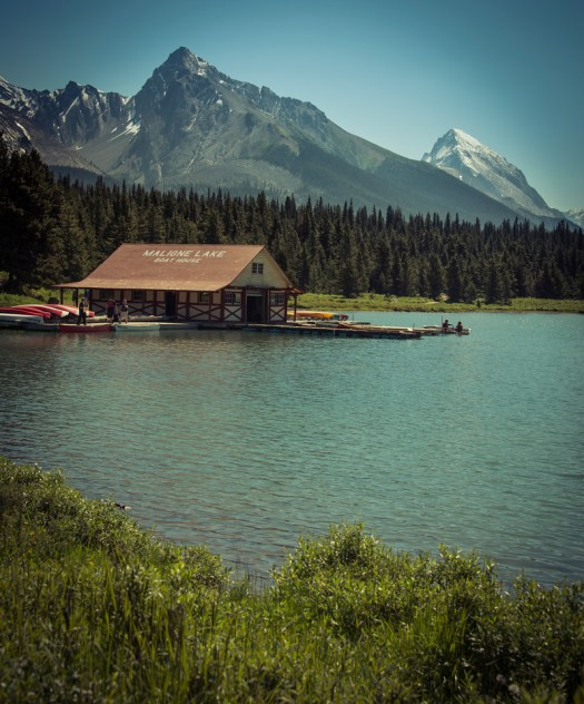 If ever there was a place to rent a canoe and be inspired by all that surrounds you it is Maligne Lake in Canada's Jasper National Park. It's about an hour drive off the highway to get here and you are rewarded with one of the most scenic settings on the continent. In fact the drive is just as awesome. We were here in the peak of summer and I sat on the deck of the lodge looking out at the lake as I took this photo.