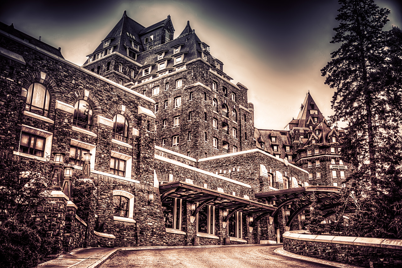 Despite the old world look, this picture was taken this summer while in Banff. This is the front of the Banff Springs Hotel and is usually crowded with cars, buses and people coming and going. However, if you're eager enough to get up at the break of dawn you just might glimpse a view that's perhaps more reminiscent of the old glory days. Not much of the Banff Springs architecture has changed in a hundred years and walking inside or around this structure you appreciate the old world grandeur normally reserved for faraway places and long passed eras. In any case, I was just glad to get this shot before the first tour bus pulled up about five minutes later.
