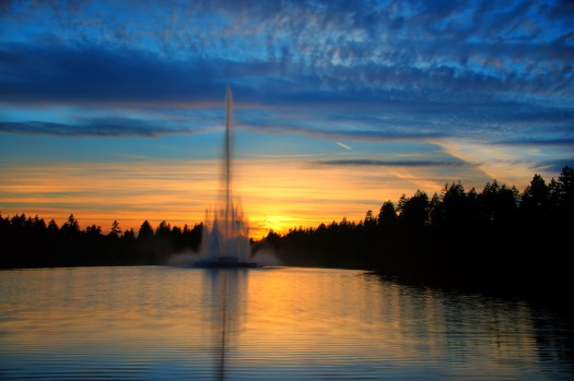 When in Vancouver I almost always walk through Stanley Park. I overheard someone say recently that it was voted the number one park in North America and I think I'd have to agree. Anyhow, you'll notice I post a lot of pictures from Stanley Park including this which was taken around sunset at Hidden Lagoon near end of summer. Just before I took this I walked past a big willow tree along the lagoon which was decorated with photos of a young couple, candles, flowers and an intimate picnic with cheese and a bottle of wine. Someone was standing guard awaiting the arrival of the couple and it was my strong impression that a proposal was to be made this evening. I'll never know for sure, but supposing that did happen, then it happened with this sunset, and so I would guess it was a very special evening indeed.