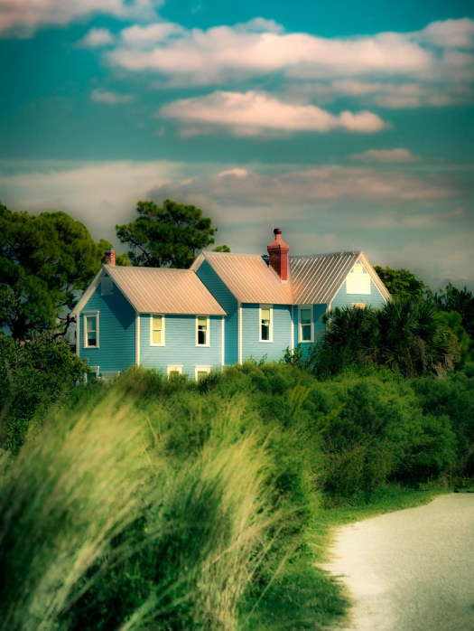 This house is the visitor's center at Robinson Preserve in Bradenton Florida. As you walk through the preserve you see this beyond the grasses. It reminds of a little house on a prairie, only it's not so little and this isn't a prairie, but you get the drift. I came here because it has a lot of wide open space and every once in a while a little space is a good thing.