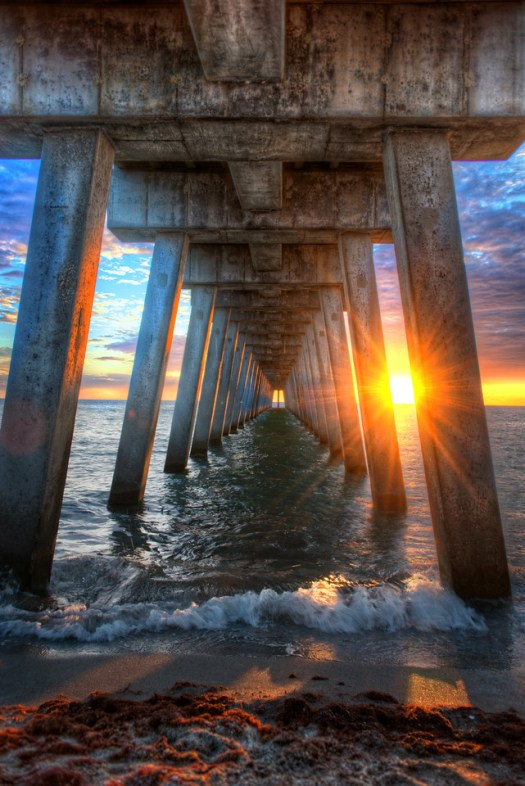 This is Venice Pier on Florida's west coast. A couple of weeks ago I found myself here with camera in hand. This is a really cool pier and at the foot of it is Sharky's restaurant which is a must see if you're visiting the area. This is one of those places we take our guests when they come down to visit. The combination of restaurant and pier on the beach in Florida is always fun. In fact, I was just talking to some friends about how we need more piers so that everybody can walk out to take it all in or go fishing for the afternoon. Of course the reason I really want more piers is so I can take pictures of them at sunset. Maybe one of these days I'll try fishing off a pier instead, or maybe not.
