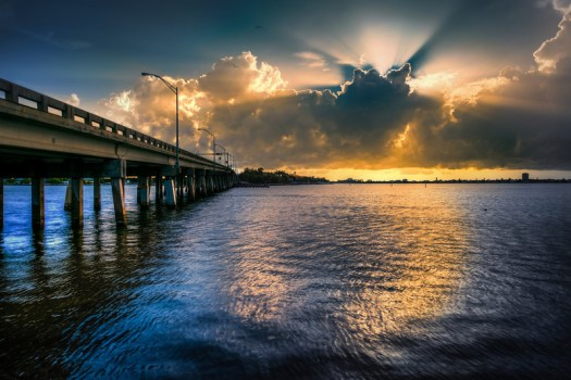 Late one afternoon I found myself with camera heading to Siesta Key and stopped at the bridge to snap this. I saw a couple of dolphins swim by but as is usually the case had the wrong lens. Now if you could just imagine dolphins swimming by this picture would be complete.