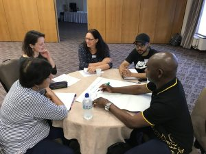 Asylum seekers and charity staff taking part in a workshop about sanctuary scholarships