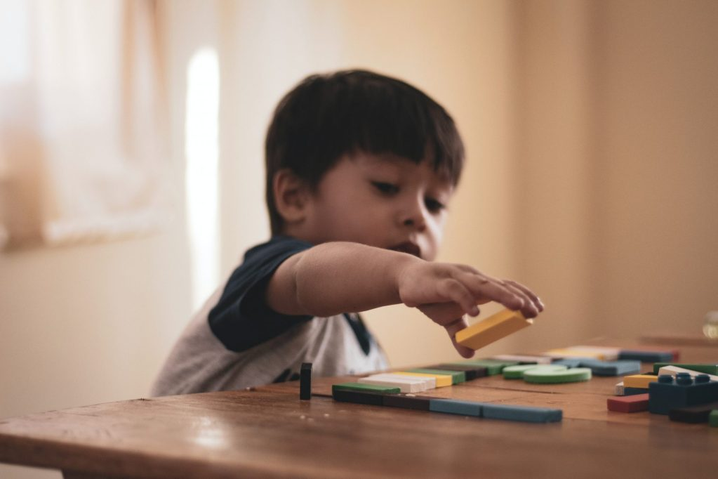 boy playing with toy blocks