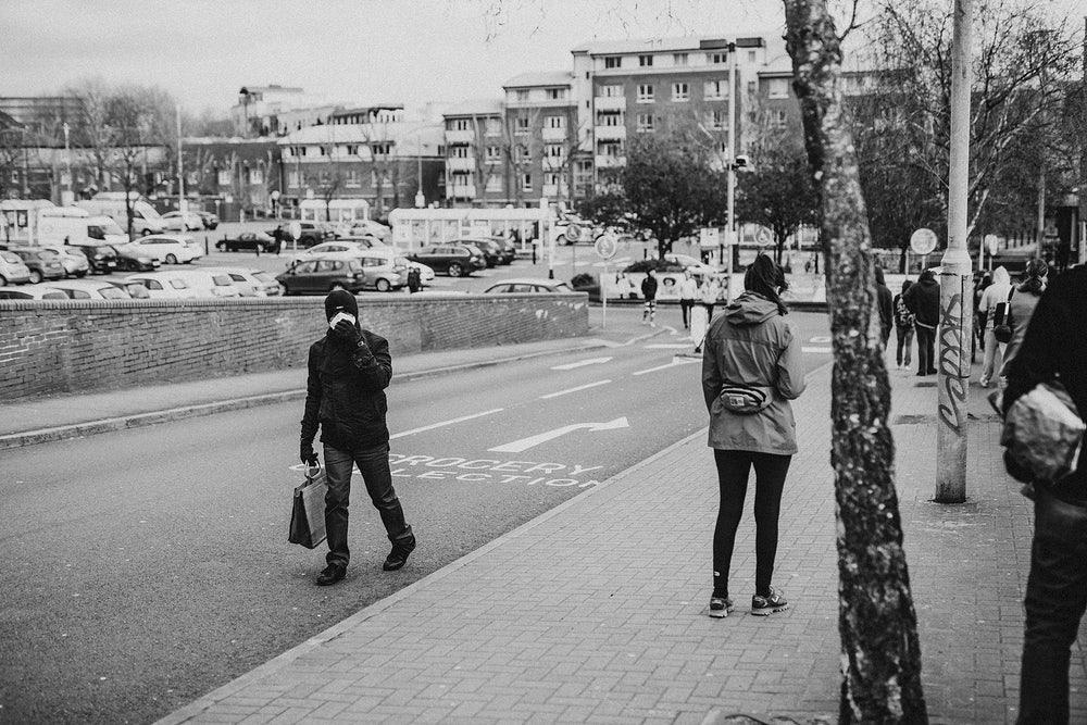 people outside blocks of flats