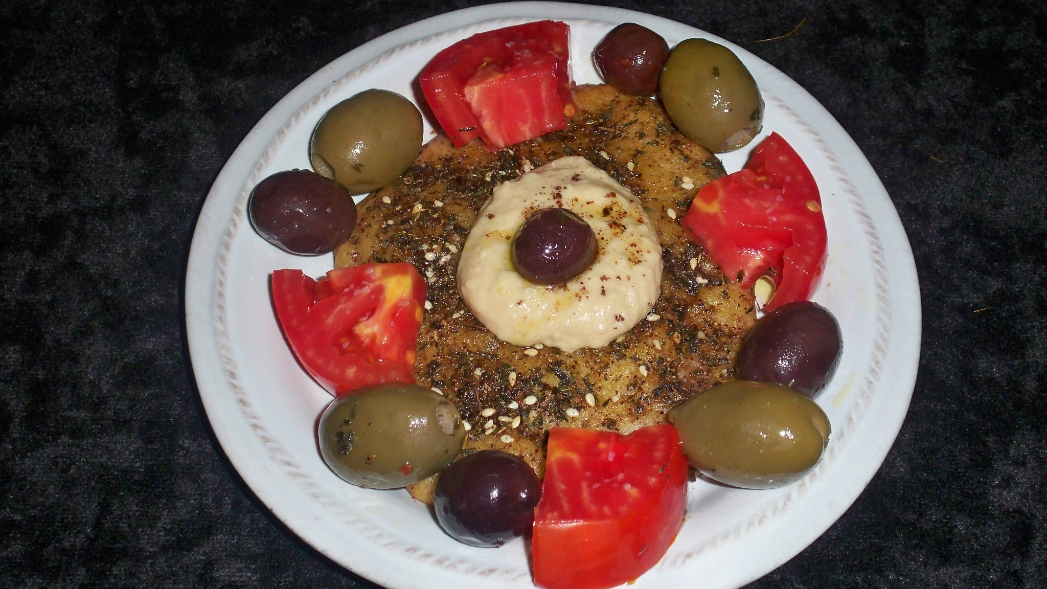 Manaeesh Appetizer with Tomatoes and Hummus