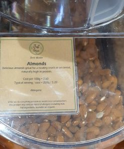 Organic almonds dispenser in the plastic free snacks and treats section Just Gaia zero waste grocery in Halifax, West Yorkshire