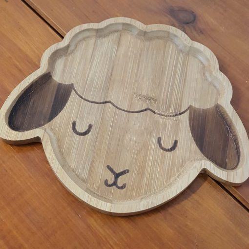 Bamboo children's plates (Lamb shape close up) on display in Just Gaia Halifax.