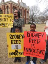 Two small children show their support at the Bastrop Co. Courthouse