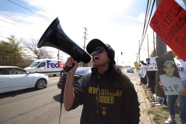 NYC Activist Mala leading chants,at the Annual Anti-Police Brutality March in Long Island, April 12th, 2014, Bay Shore, New York.
