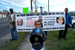 Elliana leads chants for the march, Annual Anti-Police Brutality March in Long Island, NY, Bay Shore, April 13th, 2013.