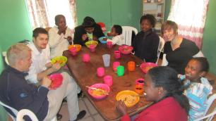 Sharing a meal with a family that lived on the church's property; we spent a lot of our time with these loving and giving people