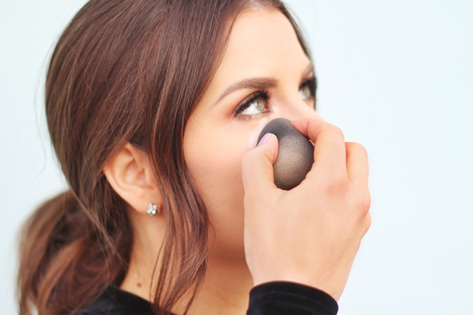 My Routine for Flawless Looking Skin   How to set your concealer with a loose powder and damp beautyblender // JustineCelina.com