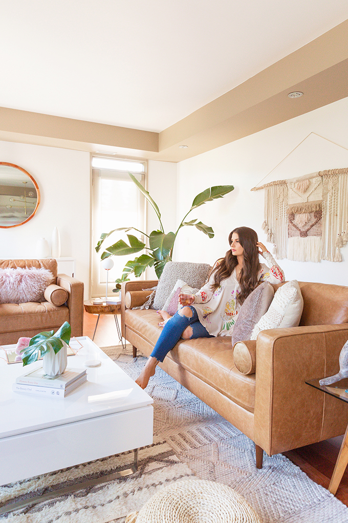 Having a glass of wine on the couch   Justine Celina Maguire's Mid Century Modern, Boho Apartment in Calgary, Alberta, Canada // JustineCelina.com