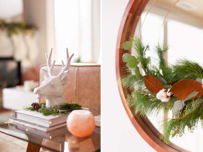 Apartment Friendly Modern Holiday Decor   White Reindeer Head Sculpture with with added greenery and fairy lights   DIY Modern Holiday Wreath with Magnolia Leaves, Cotton, Silver Dollar Eucalyptus, Seeded Eucalyptus, Cedar and Insense Cedar   Bohemian, Mid Century Modern Holiday Decor   Bohemian Holiday Home Tour 2018   Caramel Mid Century Modern Leather Couches   Canadian Tire CANVAS Ornaments // JustineCelina.com