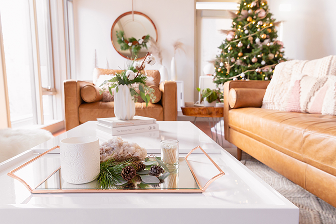 Apartment Friendly Modern Holiday Decor   Simple Holiday Coffee Table with Candles, Quartz, Fresh Greenery and Pinecones   Simple Holiday Arrangement on a Coffee Table with Greenery and Cotton Stems   Bohemian, Mid Century Modern Holiday Decor   Bohemian Holiday Home Tour 2018   Canadian Tire CANVAS Ornaments // JustineCelina.com