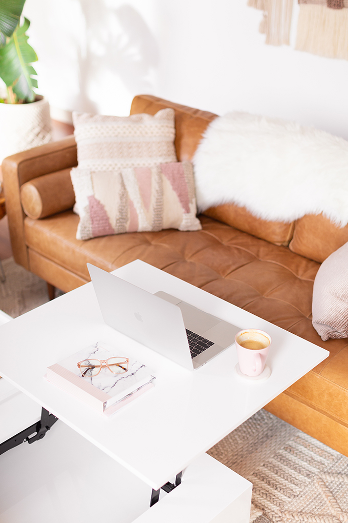 2018 Review + 2019 Goals | Calgary Lifestyle Blogger | 2019 Planning and Goal Setting | Entrepreneur Working from Home in an Mid Century Modern Apartment | MacBook Pro Laptop |  Nespresso Coffee on a White Coffee Table | Structure EVO Coffee Table in White | Bonlook Lauren Blue Light Blocking Glasses In Peach  // JustineCelina.com