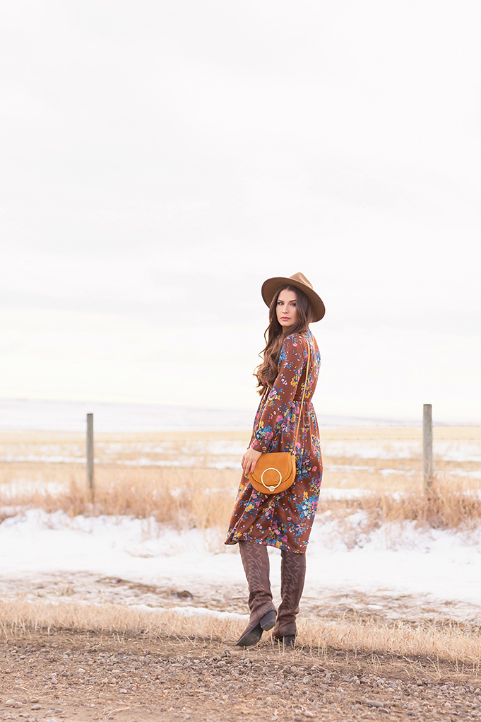 Pre Spring 2019 Trend Guide Bohemian Rhapsody: How to Style Midi Dresses for Transitional Spring Weather   Brunette Girl Standing in a Country Field at Sunrise Wearing a Brown Floral Dress, Brown Wide Brim Hat and a Mustard Cross Body Bag   Bohemian Winter Style Ideas   Pantone Spring Summer 2019 Fashion Ideas   Calgary, Alberta, Canada Fashion & Lifestyle Blogger // JustineCelina.com