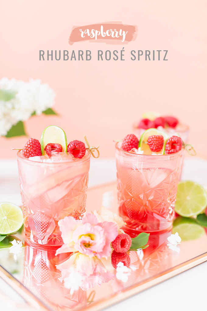Raspberry Rhubarb Rosé Spritz | A refreshing, clean, refined sugar free cocktail | A summer-inspired trio of rhubarb, raspberries and honey combine in a scratch-made Honeyed Raspberry Rhubarb Syrup to infuse this effervescent cocktail with seasonal panache, beautifully complimented by sparkling rosé, soda water, fresh lime juice and a dash of bitters | Rosé spritzer recipe | Rosé cocktail | Rosé wine spritzer | summer cocktails with vodka // JustineCelina.com
