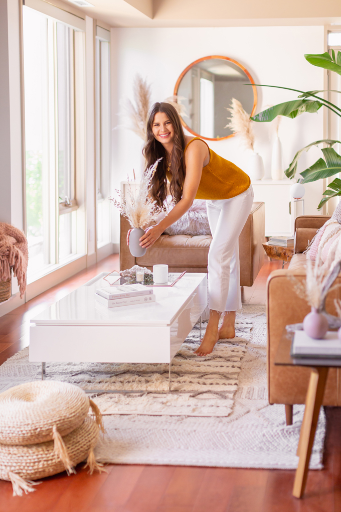 MidSummer Space Refresh Update | Smiling brunette woman with a dried Pampas Grass Arrangement in bright and airy mid century modern living room during the summer | JustineCelina's Inner City Calgary bohemian, mid-century modern apartment | A Bohemian, Mid-Century Modern Living Room featuring Pampas Grass and a Mature Bird of Paradise Plant | Summer Decor 2019 Trends | Bohemian, Mid Century Modern Decor | Calgary Lifestyle, Interior Design and Home Decor Blogger // JustineCelina.com