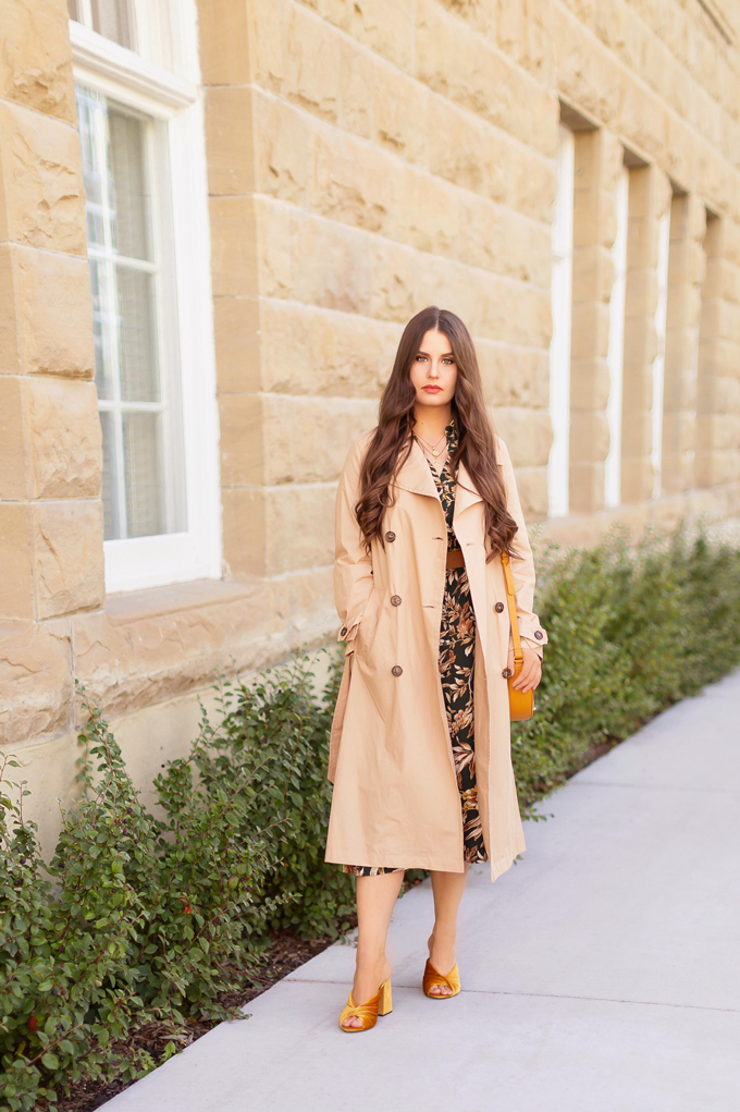 Summer to Fall 2019 Transitional Lookbook | Top Summer to Fall 2019 Transitional Trends | Top Autumn 2019 Trends and How to Wear Them | The Best Dresses for Work | Fall 2019 Professional Outfit Ideas | Brunette woman wearing an H&M Dark Green Floral Button-Down Midi Dress, Mustard Velvet Block Heeled Sandals, Mustard Leather Bag, a Mango Leather Belt with Wooden Buckle and a Mango Trenchcoat | Top Calgary Fashion & Creative Lifestyle Blogger // JustineCelina.com