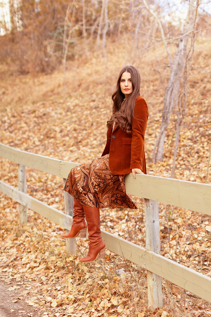 Autumn 2019 Lookbook: Equestrian Influence | Top Fall / Winter 2019 Trends | Top Autumn 2019 Trends and How to Wear Them | H&M x Richard Allen Collection Review | Brunette woman wearing H&M x Richard Allen Skirt with Belt, Cognac Corduroy Blazer, H&M Fine Knit Swearer in Beige and Lucky Brand Azoola Boots surrounded by fall leaves | Bohemian Fall / Winter 2019 Outfits | How to Style Paisley | How to Style Corduroy Top Calgary Fashion & Creative Lifestyle Blogger // JustineCelina.com