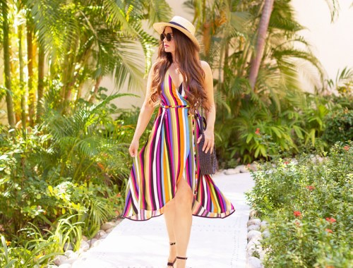 Resort 2020 Lookbook: Rainbow Stripes | Tropical Vacation Outfit Ideas | Cute Beach Vacation Outfits 2020 | Mexico Vacation Outfit Ideas | What to Wear on Vacation 2020 | Luxury Resort Fashion | How to Style Stripes 2020 | Colourful Stripe Dress Outfit Ideas | Spring 2020 Colour Trends | The Best Dresses for Tropical Vacations | Rainbow Stripe Wrap Dress | Brunette woman wearing a colourful striped wrap dress amongst tropical foliage | Camino Real Zaashila, Huatulco Review | Camino Real Resort Huatulco 2020 | Tangolunda Bay, Huatulco | Calgary Fashion & Travel Blogger // JustineCelina.com