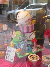 A beautiful Alice in Wonderland-themed cake I spotted in a shop window in Parma