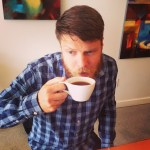 Justin Jackson drinking coffee in Vernon, British Columbia