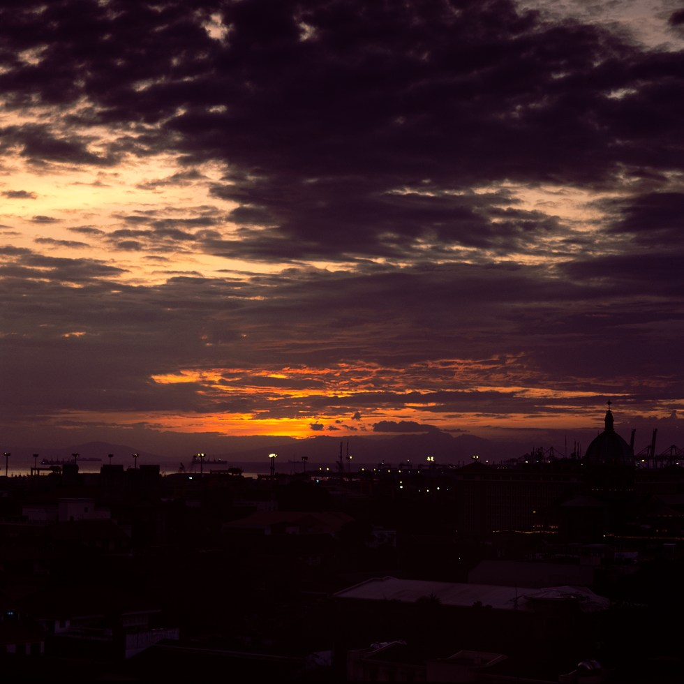 An orange sunset among the clouds over Intramuros