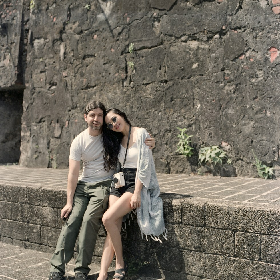 Zab and I sitting on a ledge near an inner wall at Fort Santiago